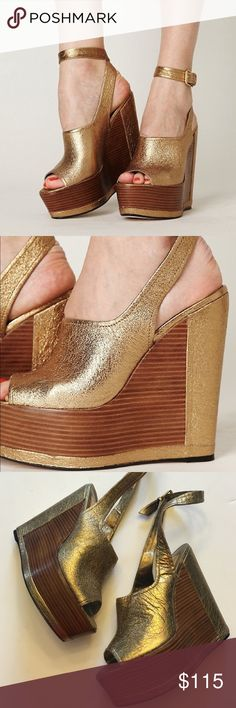 Dolce Vita Gold Foil Platform Wedges Absolutely stunning and perfect dressed up or down. Ankle strap detail. Excellent pre worn condition with slight wear to bottoms. No trades!! 0615168500def Dolce Vita Shoes Wedges