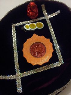 Oval shaped handmade pooja thali made from maroon velvet and exquisite silver lace