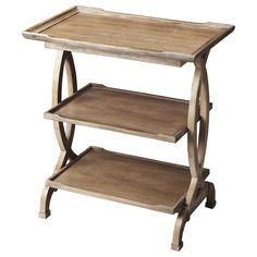 This unique accent table feature a beautiful wooden construction with a driftwood appearance and visible wood grain. The top shelf features a prominent lip, with two shelves underneath for storing and displaying your favorite items.