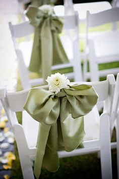 Modern aisle decor with satiny olive green bows