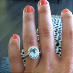 Aquamarine engagement ring! IF I do get an engagement ring it will have to be a colored stone for sure :)