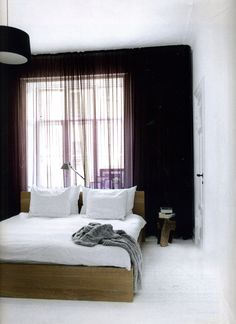 purple lights , simple wooden bed ,relaxing look
