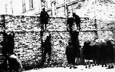 Jewish children scaling the wall to smuggle some food. Warsaw ghetto https://www.pinterest.com/rebeccadeeprose/shoah-~-never-never-forget/
