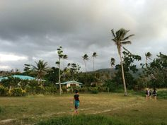One of my favourite photos of the trip, this was taken in Vanuatu, a small Pacific island, after a cyclone had hit, as you can see by the angry clouds and battered palm trees. We volunteered there for a while helping to rebuild - a truly incredible place.   Around the World in 2015   Ameesha and Nick's travels around Australia, New Zealand, Fiji, Vanuatu, Japan, Canada, America, Mexico, and Iceland.