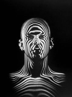 Ralph Morse - Light beams create a contour map of a human head during an Air Force study of jet-pilot helmets, 1954.