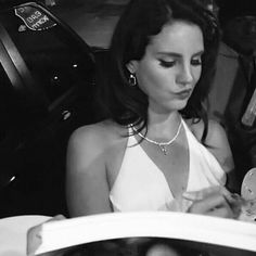 Lana Del Rey signing autographs in a white dress Paradise era old Hollywood look/glamour
