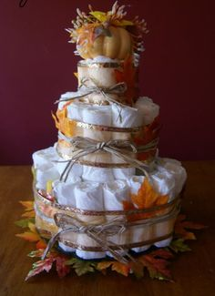 Diaper cake Table centerpieces Varying in sizes ,  new born = table 1 ; size 1 = table 2 ; size 2 = table 3....ect