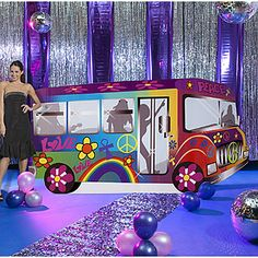 The Groovy Bus Standee features rainbows, retro flowers, peace signs and a bus load of disco dancing party goers. Each of the cardboard party bus standees measures over 4 feet high x 9 feet wide.