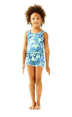 The Bala Romper is an easy play outfit for your little one. This romper is sleeveless, printed, and has pom pom details.