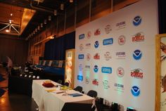 Step and repeat signage with backlit sides for New Orleans Wine and Food Experience. www.eventproducers.com