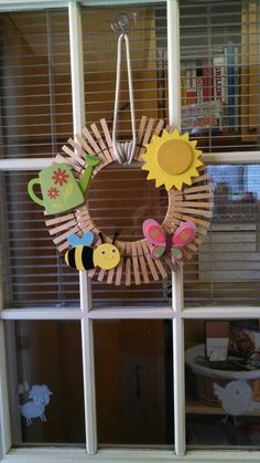 Spring/ summer wreath I made from an embroidery hoop, clothes pins, clothes lines and I found those painted wooden decoration pieces at JoAnn fabrics. Super cute and super proud of myself!