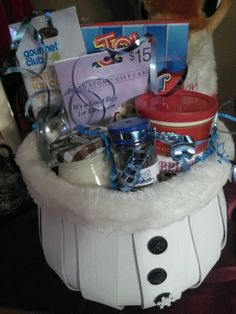 """""""Ice cream party"""" yankee swap!! Scoop,nuts,chocolate sprinkles, marshmallow, cones, and a coldstone creamery gift card :)"""