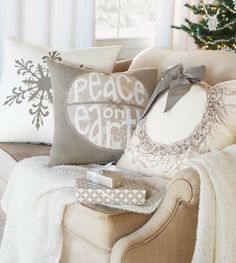 Beautiful monochrome Christmas decor inspiration with these pillows, throw blanket, and neutral seating.