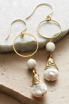 With a mix of past and present, crowns of etched antique gold top luminous Tibetan pearls, dangling from faceted shell beads and gleaming golden hoops in a design that complements casual to dressy styles. Pearl Drop Earrings - Item #1AP40