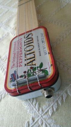 Altoids tin electric strum stick by OuttatheBoxGuitars.