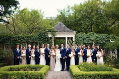 beautiful bridal party photos in philadelphia- groomsmen in blue suits, bridesmaids in mismatched gowns from amsale & adrianna papell