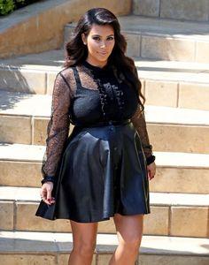 Kim Kardashian Mini Skirt - Kim Kardashian rocked a black leather mini while heading out of her home.