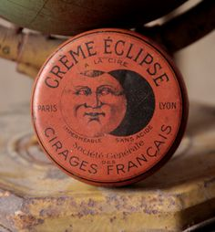 'Creme Eclipse' with moon face on old advt. tin                                                                                                                                                                                 もっと見る