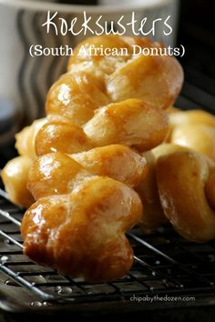 Koeksusters (South African Donuts) golden and soaked in a delicious cinnamon-ginger syrup. Enjoy these donuts or fritters cold with a cup of hot tea. South African Desserts, South African Dishes, South African Recipes, Africa Recipes, Delicious Desserts, Dessert Recipes, Yummy Food, Tasty, Donut Recipes
