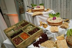 Hummus Bar ~ Several Different  Varieties of Hummus (e.g. Plain, Roasted Garlic, Sun Dried Tomato, etc.) Variety of Toppings (Olives, Sun Dried Tomatoes, Roasted Red Peppers, Dried Fruits, Nuts, etc.) Assorted Breads and Crackers