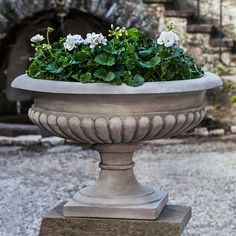 Proudly constructed in the USA from premium cast stone concrete. The Kingscote Outdoor Garden Urn is available in your choice of classic and distinct Patina Finishes.