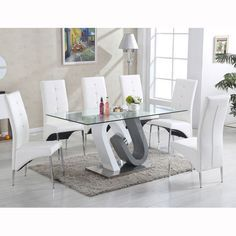 Barcelona Dining Table In Clear Glass Top With Stainless Steel Base with 6 Vesta Chairs in faux leather Select the Chairs colour from above option Finish: Clear Glass, Grey And White Gloss And Stai...