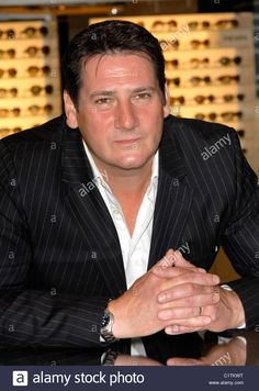 Download this stock image: Tony Hadley poses with first Wispa Gold to mark the bar's return to all good UK newsagents' shelves on September 14 following a - C1TKWT from Alamy's library of millions of high resolution stock photos, illustrations and vectors.