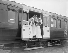 Nurses on a RAMC ambulance train near Doullens, 27 April 1918. They are members of either the Queen Alexandra's Imperial Military Nursing Service Reserve or the Territorial Force Nursing Service.
