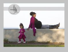 portrait of a mom and daughter pregnant with 2nd child at an outdoor chicago location