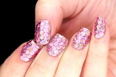 These pink sparkling nails are too cute!