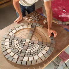 """diy: outdoor mosaic table"" - *eyebrow* Includes bending the steel legs. Which is actually pretty simple from the looks of it, but for some reason I'm still impressed that it's in a DIY tile garden table tutorial."