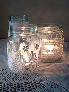 Lace covered votives... these look like baby food jars covered in lace!