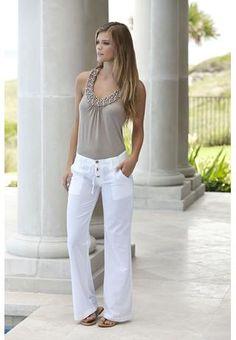 Pearl Trim T-Back Halter in Tan/Natural. Faux pearls adorn the scoop neckline of an elegant shoulder-baring halter top.