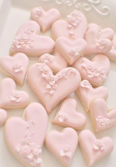 Pink heart shaped cookies, in assorted sizes.