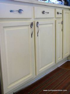 Make handles for your kitchen cabinets using silverware!