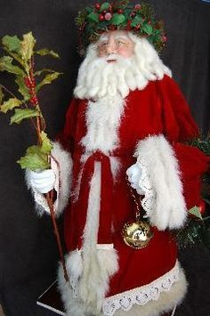 Another of my hand sculpted Santa's.  I curled his beard and hair.  He has lots of vintage fox fur trim.   Visit www.snowflakebay.com