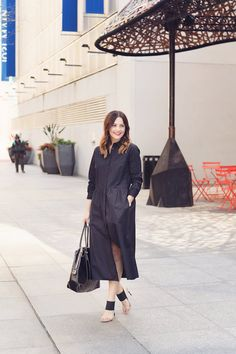 Caroline styles a black shirtdress