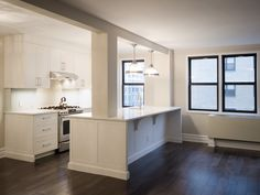 """Maximize Your Small Space by Creating an Open Floor Plan.  Removing or reducing barriers helps add light and create a better flow between spaces. """"To achieve an open kitchen, dining-living room and entertaining space, this small Upper East Side apartment required a gut renovation,"""" McDonald says. """"By removing the walls, changing the sink location, adding seating and upgrading lighting and finishes, we created a glamorous contemporary apartment."""" - Paula McDonald   #kitchen #renovation #NYC"""