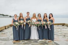 Photography : Leila Brewster | Guilford Yacht Club Wedding | Bridesmaids | Bride | Blue Dress | True Event | http://www.trueevent.com http://www.stylemepretty.com/connecticut-weddings/guilford/2015/04/03/elegant-waterfront-wedding-at-the-guilford-yacht-club/