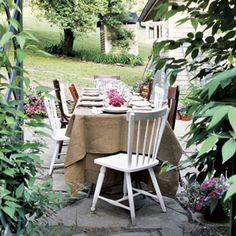 Set up a long table on a patio or cover two smaller tables with a tablecloth for a relaxed gathering. Mismatched chairs add to the laid-back feel. Add a touch of color with small bouquets running down the center of the table.   - Delish.com