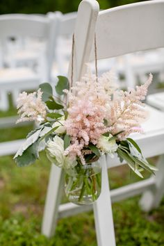 Blush pink astilbe decorates the aisle