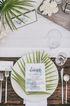 Add some natural elements to each place setting. A clean palm frond across every…