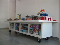 {Lego Table}  I'd like to do something like this for a Lego table.  I love the idea of pulling it out from the wall so two kids can play on it.  The storage is great. perhaps a cover board and frame to allow kiddos to use as table top