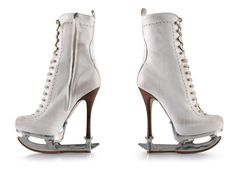 Wondering if I could actually skate on these.  Hmmm, interesting blade.  Toe pick on back of blade???