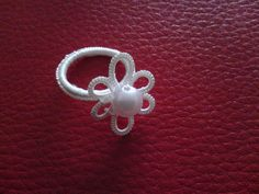 Tatting Ring Flower by TheLacyNook on Etsy https://www.etsy.com/listing/222844075/tatting-ring-flower