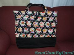"Tote Bag with 3 interior pockets, 3 exterior pockets. Details: Approx. 18 1/2 "" height X 20"" width. SOLD."