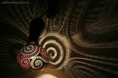 It's a lamp, which doubles as a work of art. The design in the background is the light that the lamp shines. Gourd Lamp, Organic Art, Cool Lamps, Light Art, Light And Shadow, Fairy Lights, Solar Lights, Exotic, Carving