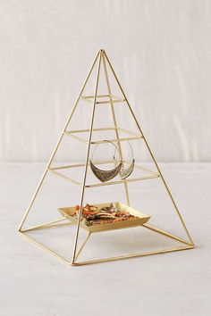 Magical Thinking Pyramid Jewelry  Stand  If you're like me, I LOVE all kinds of things like this to display jewelry or certain things.  Comes in bronze and black. $29.00