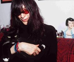 Affectionately Cool Black cat gettin' wit Lead Singer, Joey Ramone --- ( I don't wanna be a Pinhead no more, I just met a nurse that I could go for, [[:  neer-na neer na neer na  :]]