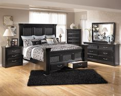 Ashley Furniture Cavallino Bedroom Set with Mansion Poster Bed, Storage Footboard. Bed only $799.95